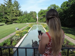 A visitor uses the Cranbrook House and Gardens mobile app